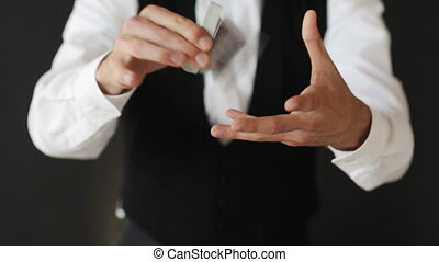 man showing trick with playing cards - magic, card tricks,...