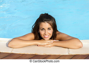 Smiling in a swimming pool
