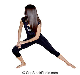 Fitness model stretching - A latina fitness model in a black...