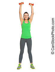 Full length portrait of happy fitness young woman making exercise with dumbbells