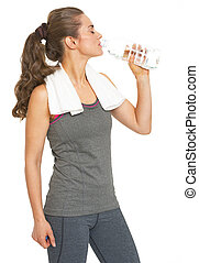 Healthy young woman drinking water