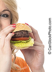 Model Released. Attractive Young Woman Eating a Beef Burger
