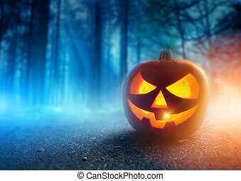 Spooky Halloween Night - A glowing Jack O Lantern in adark...