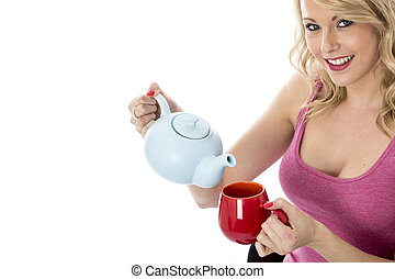 Model Released Attractive Young Woman Pouring Tea from a...