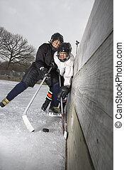 Boys playing ice hockey. - Ice hockey player boy slamming...