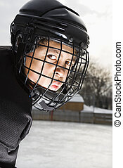 Ice hockey player boy. - Ice hockey player boy in uniform...