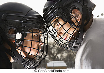 Ice hockey confrontation - Two ice hockey players in uniform...