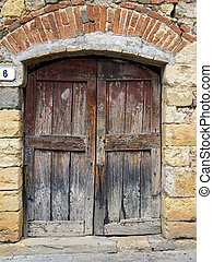 wooden old door of stone house - unstripped wooden old door...