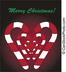 Christmas candy sticks form a heart on dark background