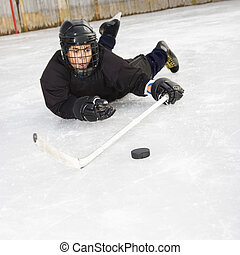 Ice hockey player - Ice hockey player boy in uniform sliding...
