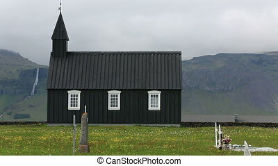 Wooden church - Black wooden church in front of a mountain...