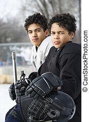 Boys in hockey uniforms. - Two boys in ice hockey uniforms...