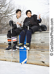 Boys in sports gear. - Two boys in ice hockey uniforms...