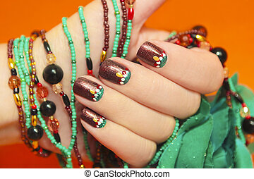 Turquoise nails. - Women's nails are covered with brown...