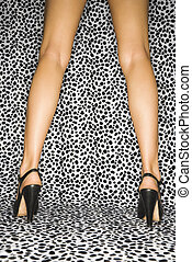 Female legs in heels - Back view of Caucasian female legs...