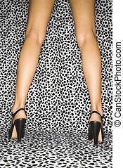 Female legs in heels - Back view of Caucasian female legs...
