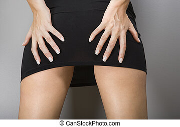 Female hands on buttocks. - Close up of Caucasian female...