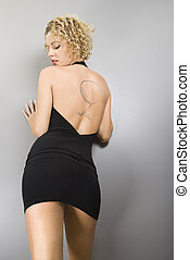 Woman with back tattoo. - Back view of Caucasian young adult...