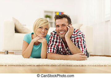 Portrait of loving couple on the floor in their house