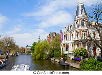 One of canals in Amsterdam old town, Netherlands