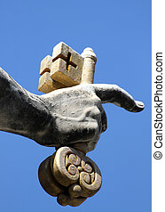 hand of san pietro in Vatican City keeps firmly in his hand...