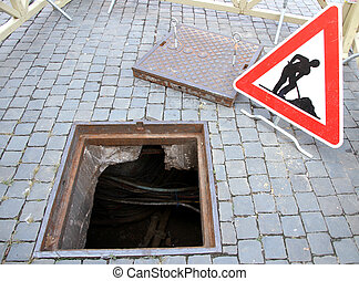 manhole opened for excavation and repair the cable and the...