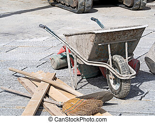 paving work wheelbarrow bucket and broom - paving work with...