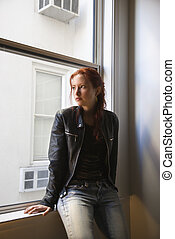 Young woman portrait - Pretty redhead young woman sitting...