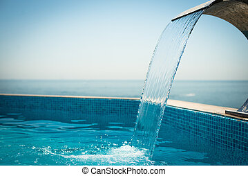 Swimming pool at the sea. Luxury hotel