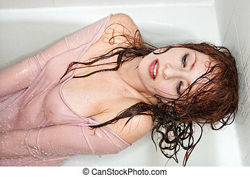 Sexy woman in tub.