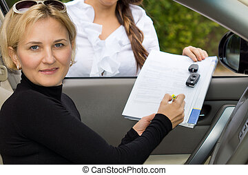Woman purchasing a new car - Attractive mature blond woman...