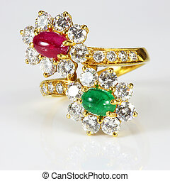 Golden Ring with Diamond and gemstone on white background