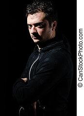 Dangerous man - Portrait of a dangerous man with an...