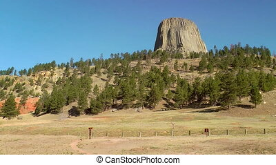 Devils Tower National Monument - Car driving past the Devils...