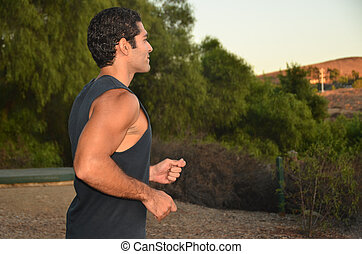 Physically fit man - Young physically fit man working out...