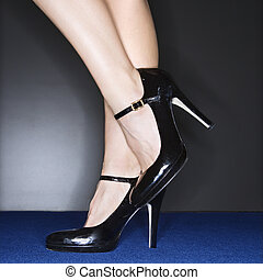 Woman in high heels. - Sexy female legs wearing high heels.