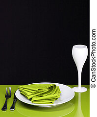Dinner Table - A modern green dinner table with utensils and...