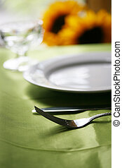 Fine Dinning - An elegant table set for dinner with shallow...