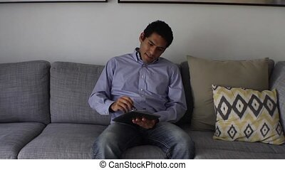 handsome Man at home using tablet