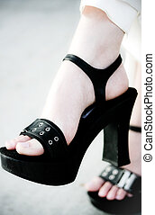 Urban Fashion - A close up of a womans foot in high heels...