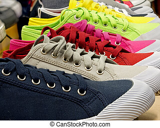 colored sports shoes, rubber and canvas - colored sports...