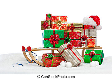 Santa sledge loaded with gift wrapped presents - A sledge...