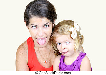 Mother And Daughter Making Silly Faces with tongue out