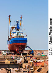 Fishing trawler in a shipyard