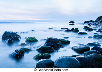 Rocks in the Irish Sea early morning - Bray Head rocks in...