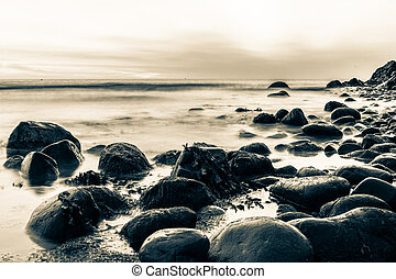 Rocks in the Irish Sea in sepia - Bray Head rocks in the...