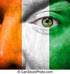 Irish flag painted on mans face to support his country...