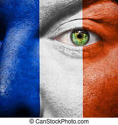 French flag painted on mans face to support his country...