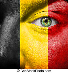 Belgian flag painted on a man's face - Belgian flag painted...