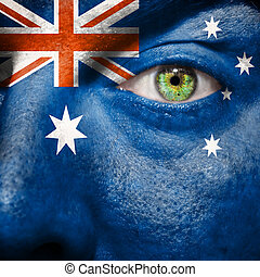 Australian flag painted on a man's face to support his...